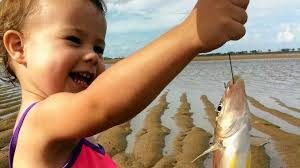 excited child fishing